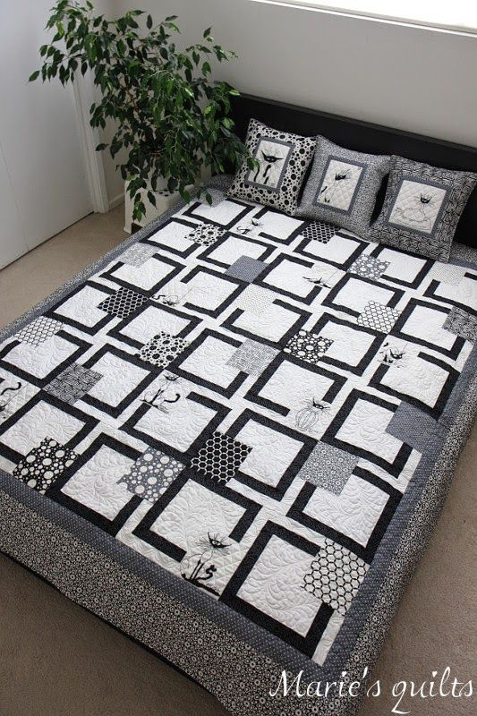 I rarely see quilted bedding that I like in white black and grey but this is interesting and has cohesion.