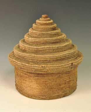 """Box made from stringed roots (""""tæger""""). 32 cm high.    Acquired by Telemark Museum (Norway) in 1891."""