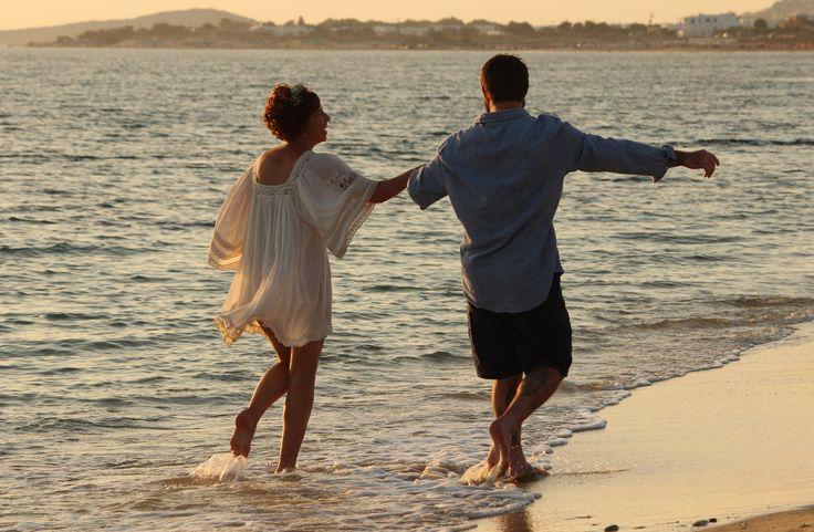 Newly wed couple celebrating their love on the sparkling beach of Plaka Naxos. Weddings by islandevents.gr naxos wedding planners. Greek destination wedding planners.