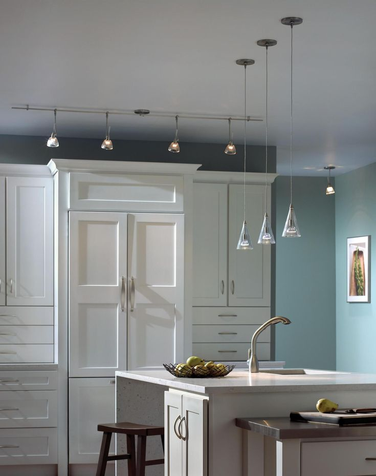 Astonishing Three Mini Pendant Lights Over Kitchen Island In Sky Blue Decoration Features White Finish Cabinets And Traditional Wood Bar Stool Also