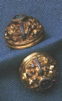 "The Högom find: ""A couple of the elaborated gilded silver clasps from the chamber in large mound no. 2 in Högom."""