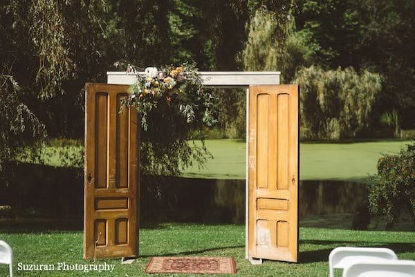 Freestanding Barn Doors Create A Surprising Entry To The Altar With These Freestanding Vintage Barn Doors This I Barn Door Tall Cabinet Storage Outdoor Space