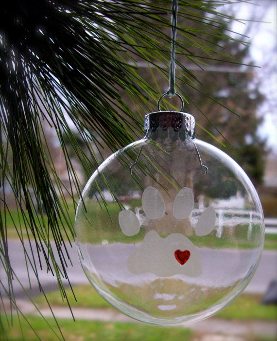 a paw print has been etched onto a clear glass ornament and a red heart rhinestone adhered in the lower right corner of the paw print.   etched glass paw print ornament pet ornament by JDooreCreations, $14.00