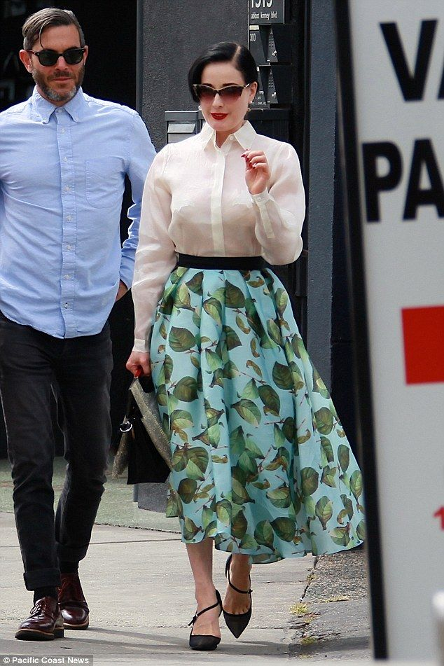 Sheer appeal: Dita Von Teese stepped out in a see-through blouse with her bra clearly visi...