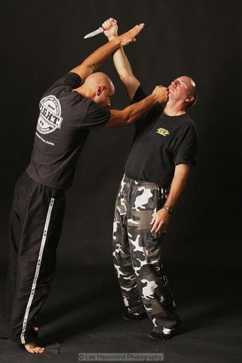 Krav maga knife defense demonstrated by Master Tiano and Sensei Pulsone
