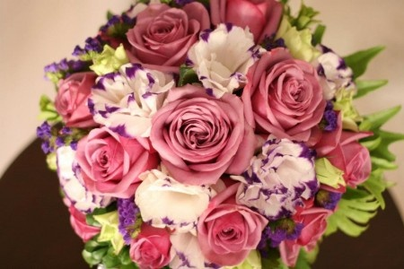 A Bridal Bouquet using Pink Roses, Violet and White flowers.  Bouquet By: Jacqs Floral Design Studio