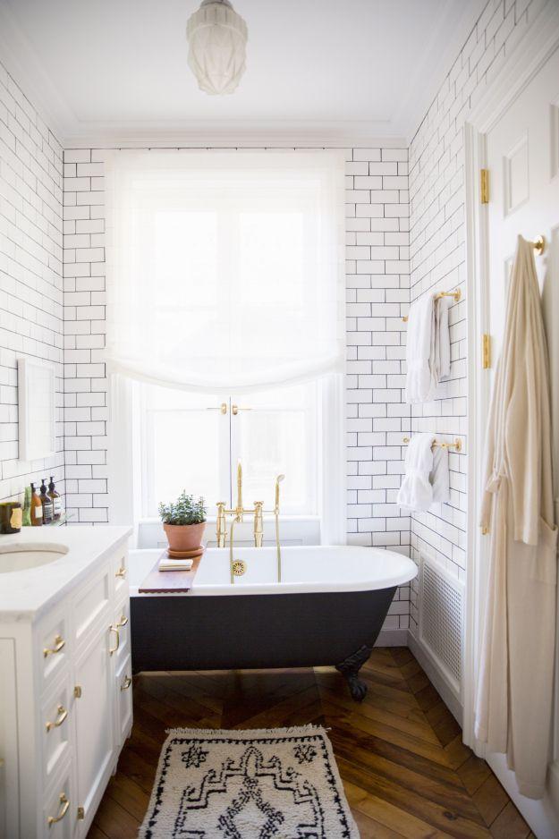 Ali Cayne bathroom black bathtub brass accents