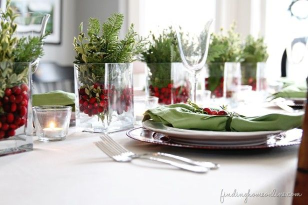 Finding Home -  easy centerpiece - glass containers, fresh cranberries and springs of pine and boxwood.  Intersperse with votives in glass holders.