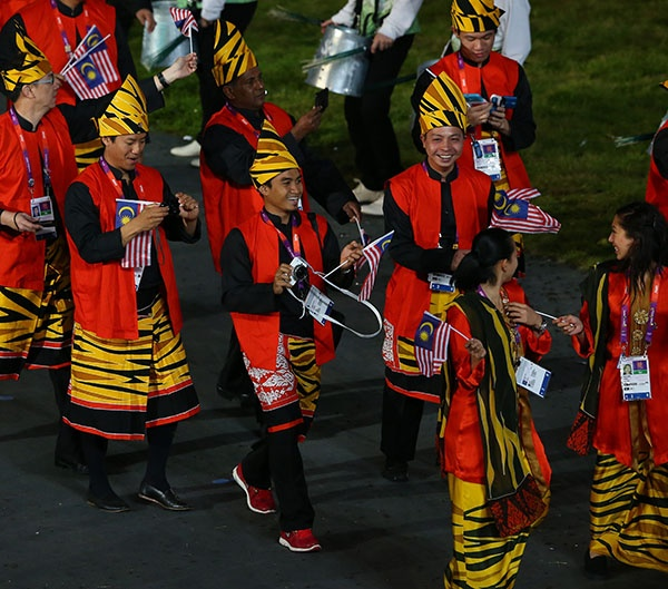LONDON, ENGLAND - JULY 27: Malaysian athletes parade during the Opening Ceremony of the London 2012 Olympic Games at the Olympic Stadium on July 27, 2012 in London, England. (Photo by Alex Livesey/Getty Images)