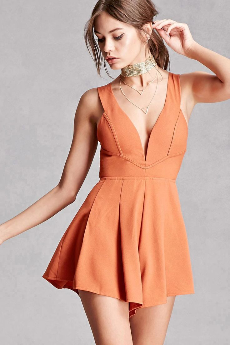 This sleeveless romper by Selfie Leslie™ is made from a textured stretch knit and features a pleated flare, a deep V-neckline, padded bust with a V-wire, a cutout-back with faux suede ties, and a concealed back zipper.