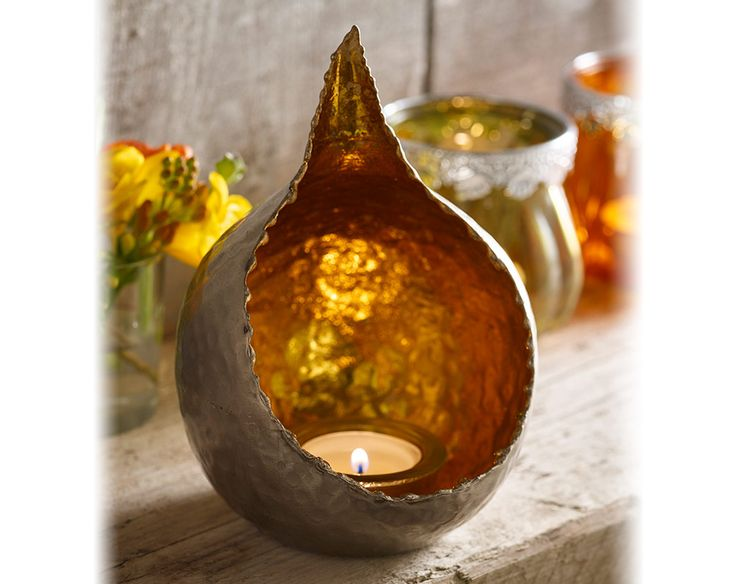 The candle glow will really bring out the gold coloured tea light holder, giving your home a warm glow, approx. H17 x W11 x D9cm (tea light not included) FREE DELIVERY on orders over £50.
