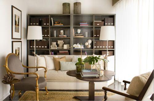 high coffee table, furniture arrangement, bookshelves, floor lamps