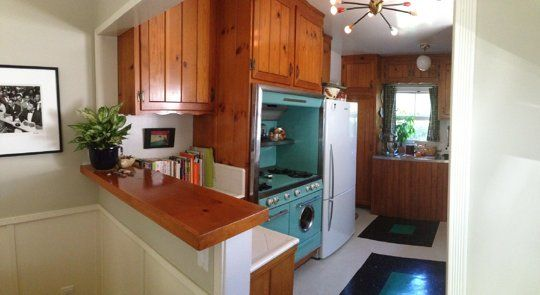 The stove unit sold me!    Jocelyn & Roger's Classic Knotty Pine Kitchen Small Cool Kitchens 2013