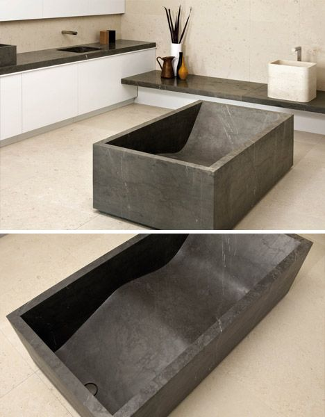 Put this tub in my dream bathroom.  from dornob.com.  They have other great carved stone tubs. Ahhh!