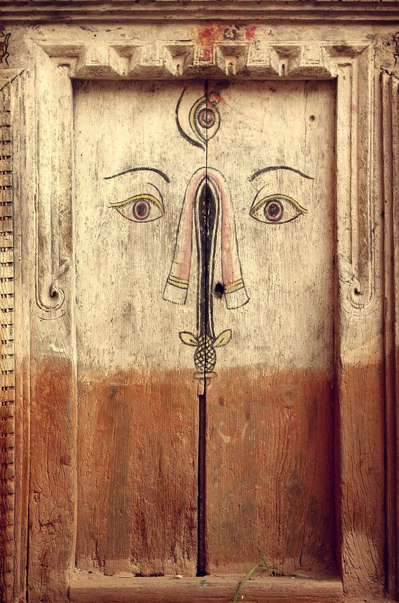 Wooden doors with face | Nepal