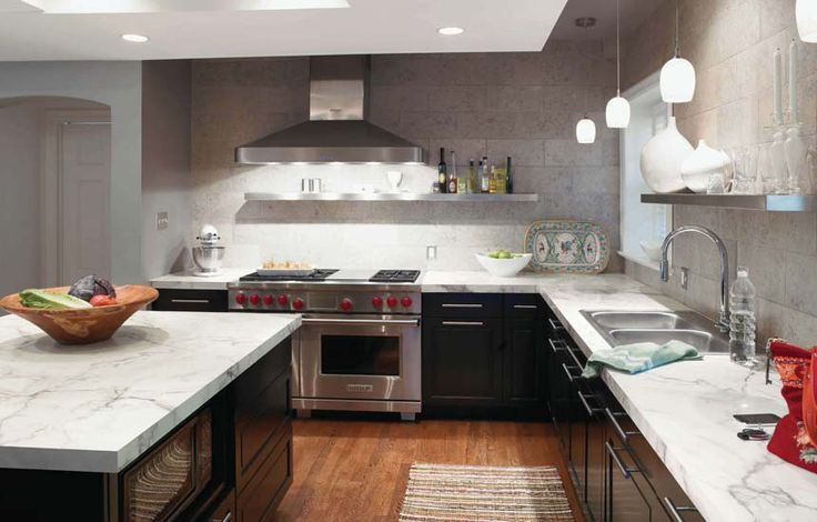 calacatta marble formica countertops with hardwood floors and black cabinets! yes!