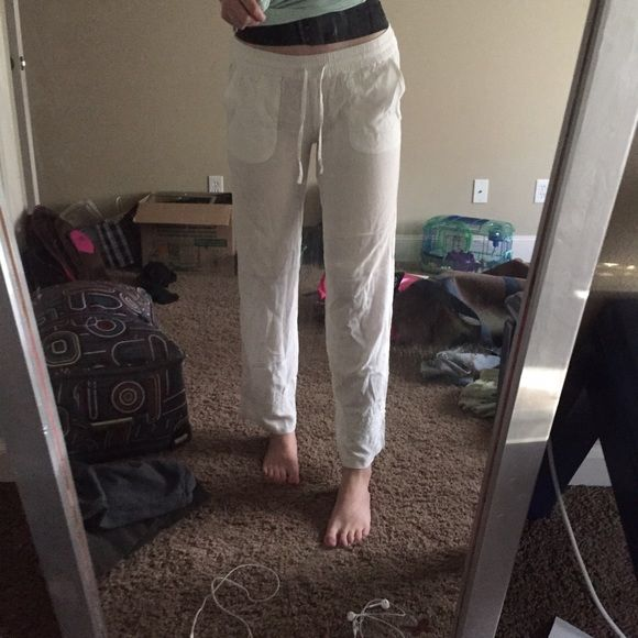 "White beach pants White beach pants! Perfect for the beach or pool or even just a relaxing day. White cotton, detailing toward the bottom of the pants. Sadly, as you can see they are for someone shorter than I, for reference I'm 5'8"" PacSun Pants"