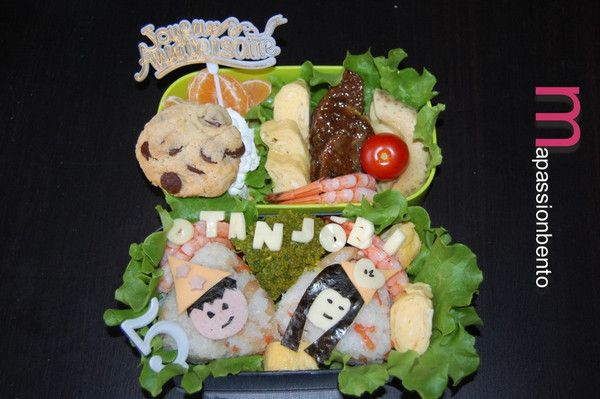 "This week, the theme of Bento Weekend was ""Birthday Bento"", marking the fifth anniversary of the creation of Bento&co.  For her submission, Delphine from the blog MaPassionBento has prepared a festive bento with two small figures ready to celebrate the event. ^ ^  Some explanation from Delphine:  http://en.bentoandco.com/blogs/news/10468885-bento-weekend-20-results-birthday-bento"