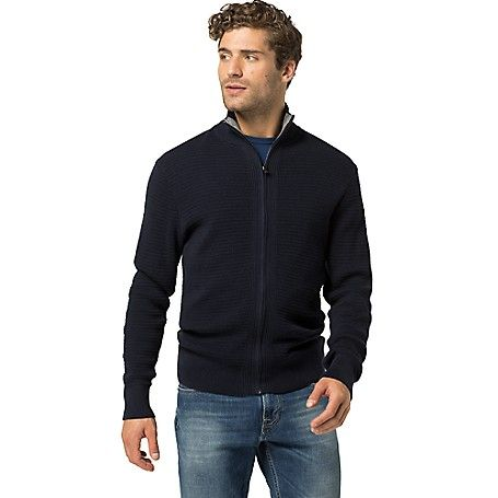 Tommy Hilfiger men's sweater. Our best-selling cardigan silhouette updated in a textured knit. A layering staple and softer jacket alternative for the transitional months. <br>• Custom fit.<br>• 100% cotton.<br>• Ribbed trim. <br>• Machine washable.<br>• Imported.<br>