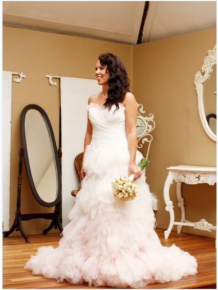 Nina in her unique Joss Bridal Wear princess-style dress.