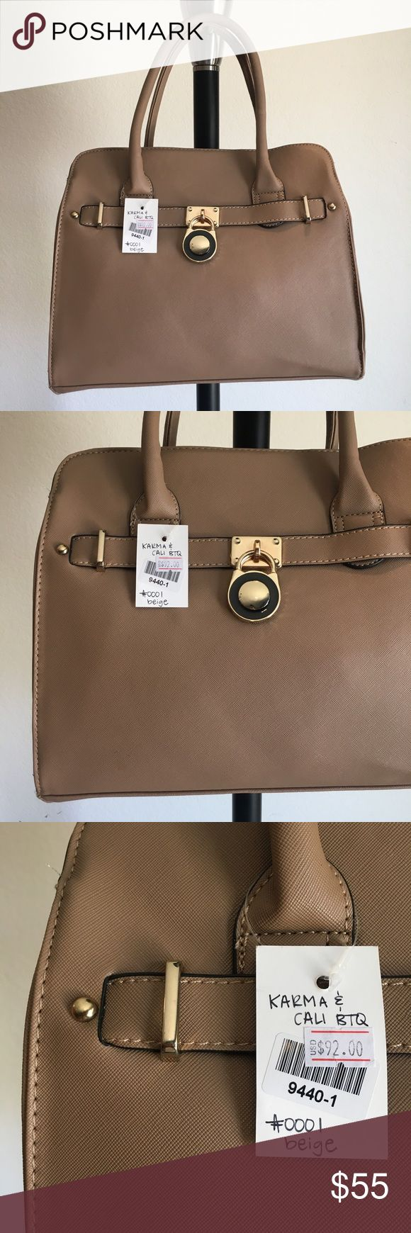 "👜 Tan Trendy handbag / purse 🔥Brand New Boutique Item handbag (brand new with tags) ONLY 1 of this color and style available! By Karma & Cali Boutique 👜 -Color: tan colored handbag with gold hardware, hanging lock, and optional cross body strap -Dimensions: 14"" length, 11.5"" height, 5"" width, 6.5"" strap drop -Details: 2 interior pouches, 2 zippered pockets  -Materials: soft animal friendly VEGAN LEATHER, easy to clean, creases iron out with use, *cannot be restocked Karma & Cali Boutique…"