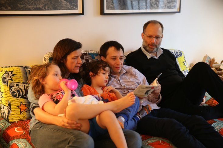 Twins Viva and Felix curl up with mom, Kirsten Johnson, and two dads, Boris Torres and Ira Sachs, right, at Kirsten's apartment in New York City. Janu...