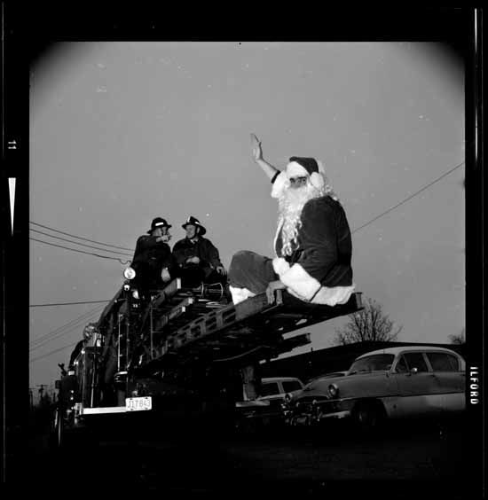 Fireman at Children's Hospital with Santa, Dec. 16, 1966. (Photo via Vancouver Public Library)