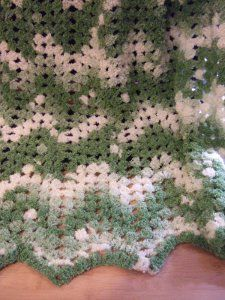 We know it can be a challenge to find chain stitches while crocheting with boucle yarn, which is why this No Beginning Chain Ripple Blanket is so great. If you want to know how to crochet a blanket easily, this free crochet pattern is perfect.