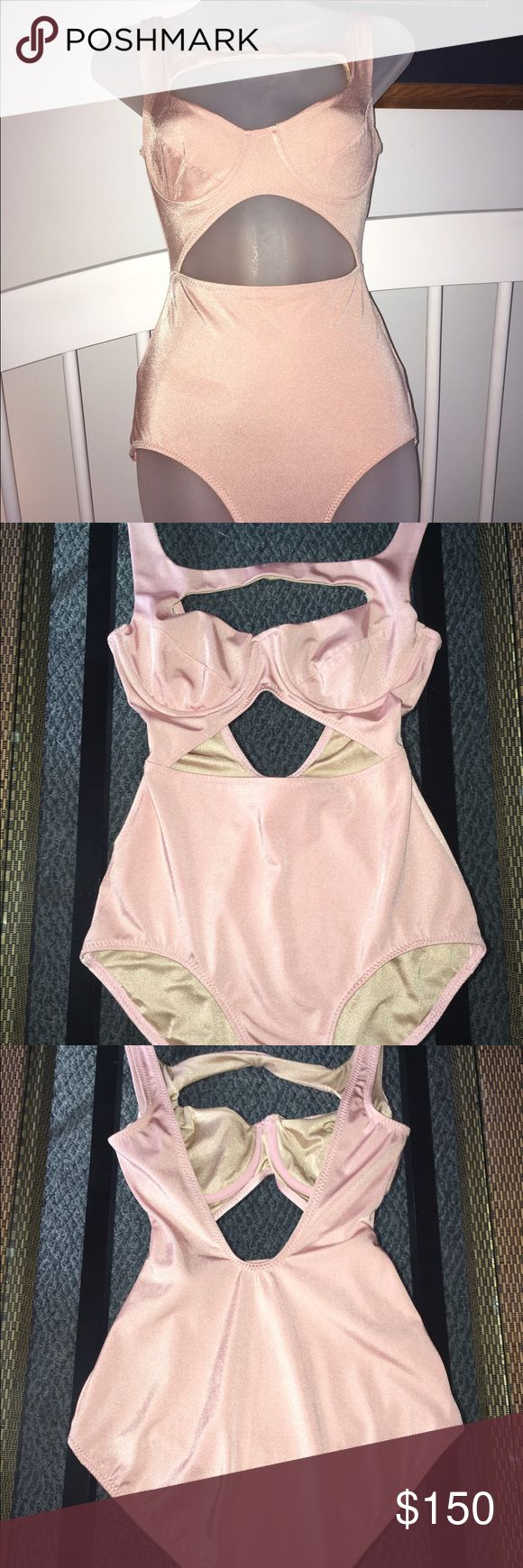 Vintage Norma Kamali Pin-up Pink Cut-out Swimsuit Excellent condition. No trades. Price firm unless bundled. Norma Kamali Swim One Pieces