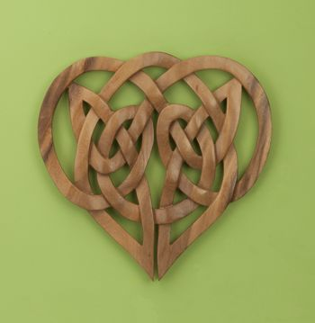 Handcarved Celtic Knot Heart...looks so beautiful! Carved from a single piece of rain tree wood.