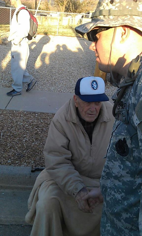 SSG Guy Hurd shakes hands with a Bataan Death March survivor during the Bataan Memorial Death March in New Mexico.