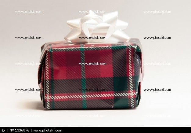 http://www.photaki.com/picture-red-gift-with-white-ribbon-and-tie_1336876.htm