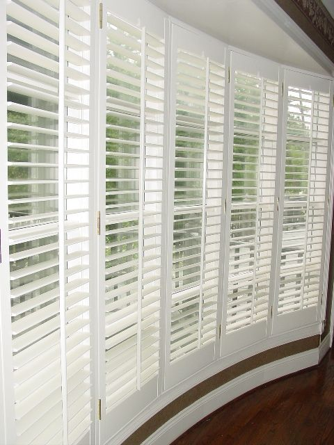 side view of shutters in a bow window, framed, beautiful! bow window treatments | Bow Window 2.5 in Plantation Shutters.jpg