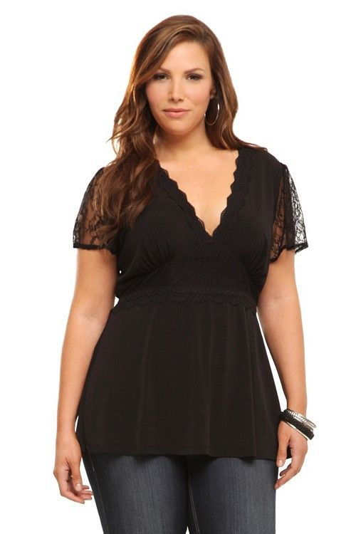 Lace flutter sleeves and trim lend gorgeous detail to a black top. A deep V-neck meets a lacey empire waist for a sexy but classic look.