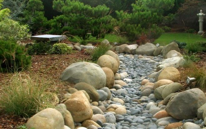 Asian landscape by urban oasis river deck and garden - Rock bed landscaping ideas ...