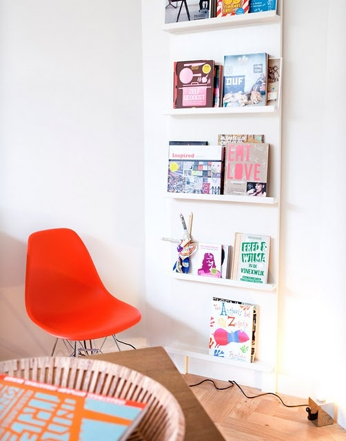 this looks slightly like a doctors office or public library, but i think the skinny shelves for magazines or small books is inspired