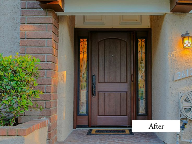 Plastpro Rustic Style, single 36'' door and double 10'' side lights. Door model DRA2A two panel arch atop with plank. Camelia wrought iron full glass side