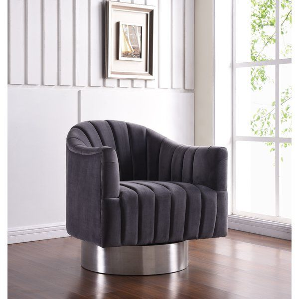 Relax and unwind in this Bekah Swivel Barrel Chair. A beautifully modern design with hints of retro flair epitomizes this lovely chair, which rests on a stainless steel base for a sleek, modern touch. Get in Navy Blue with Gold base, Black with Gold Base, or Ivory with Gold Base.