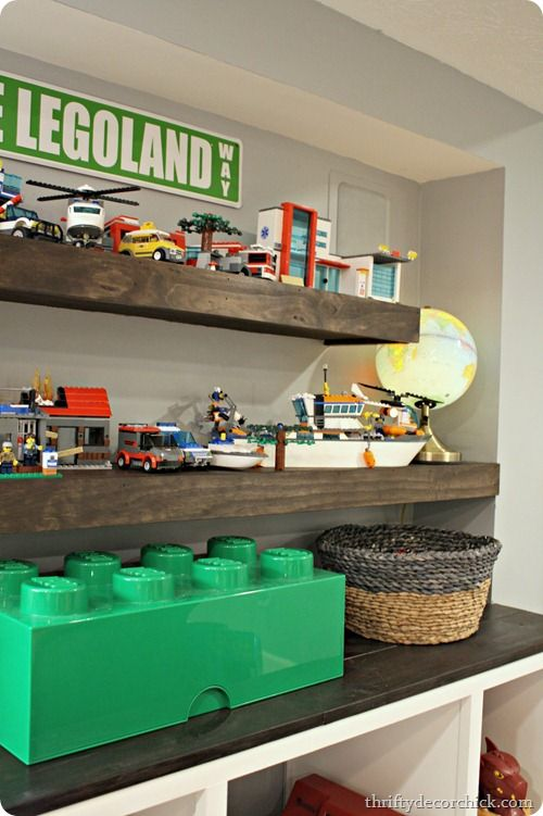 DIY floating shelf with a dark stain, would be great for my boy's room