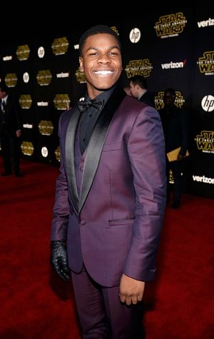 Lead actor John Boyega (Finn) steps out in a royal purple suit and a black bowtie.