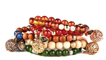 GENIUS! Scented jewelry from Lisa Hoffman... Bracelets, necklaces, and earrings that have Eco-friendly scented beads inside (refillable too!)