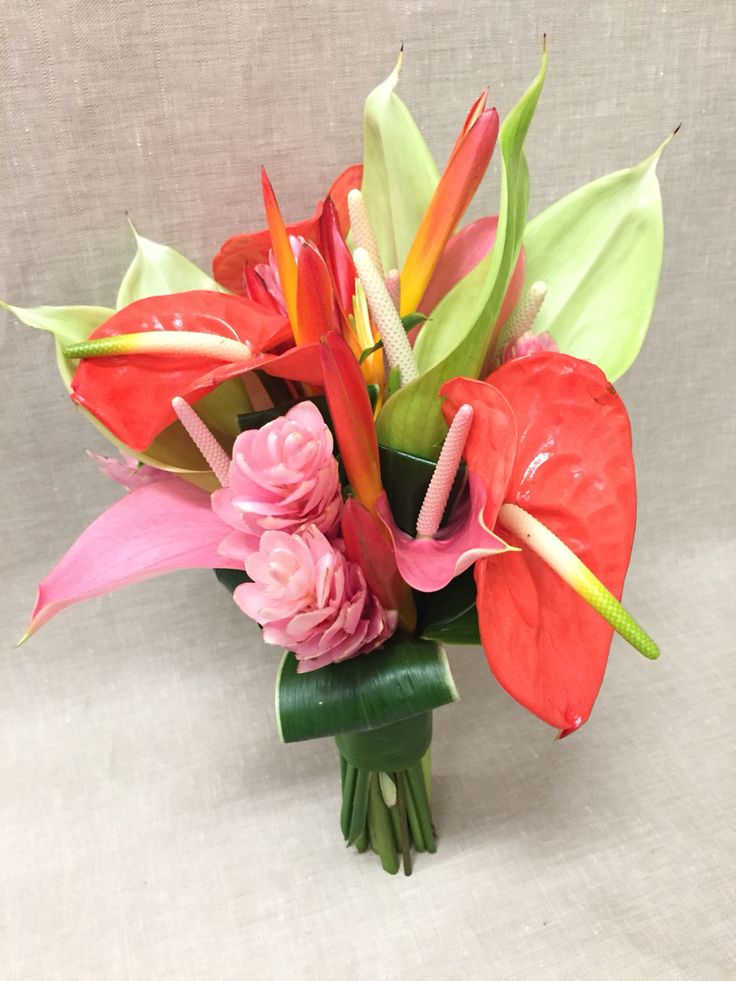 Pink ginger coral anthurium parrot bright tropical wedding bouquet