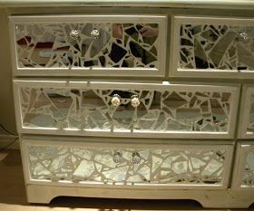 Shattered mirror pieces applied to dresser drawers are an awesomely different take on the mirrored furniture look!