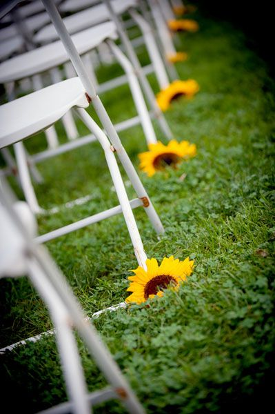 Punch up the aisle with a simple sunflower at each row. For the ceremony