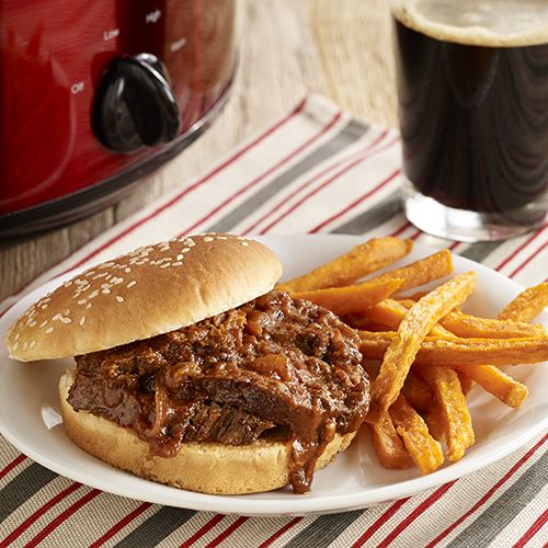 Slow cooker beef recipe of brisket cooked in an onion beer sauce for beer braised brisket to slice and serve on sesame seed buns
