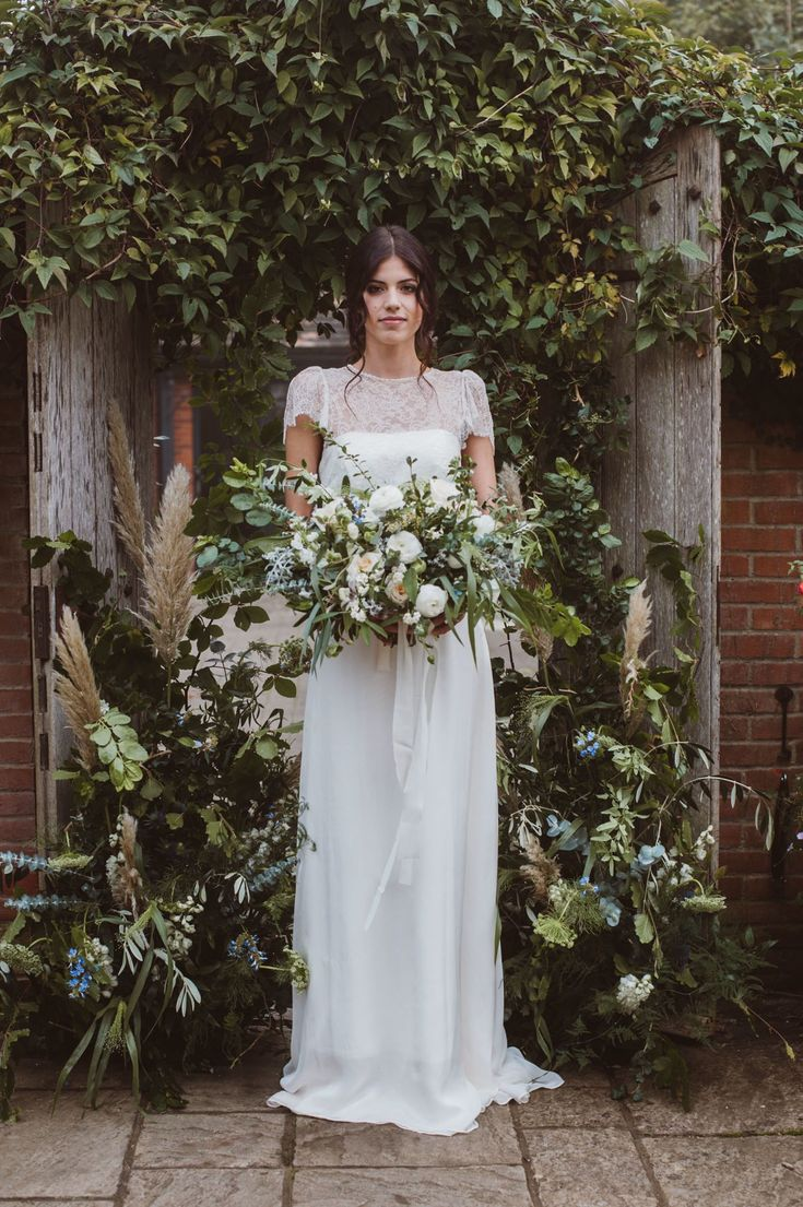 Blue Skies S/S 18.  'Cowslip' Wedding Dress by Jessica Turner Designs photography by Kitty Wheeler Shaw.  Dress Designer: @jessturnerdesigns  Photography: @kittywshaw  Venue: @weddingweekends Hair & Make Up @stormemakeupartist Flowers: @sarahharperflowers Ribbons @katecullenstyle Model @jessica_stimolo Bird Design @sherylcole