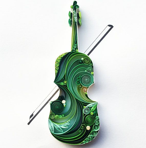 This quilled paper artwork named Violin is handmade from colourful strips of paper. Its placed in a white deep frame, sized 23x32 cm This piece of