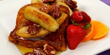 French toast with caramelized bananas and pecans