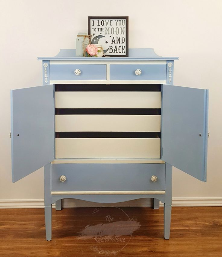 My third Annie Sloan piece, (inside view.) This antique dresser was painted in Louis Blue with Old White Detailing and drawers (inside.) I then used AS Silver Gilding Wax to bring out the detailing.