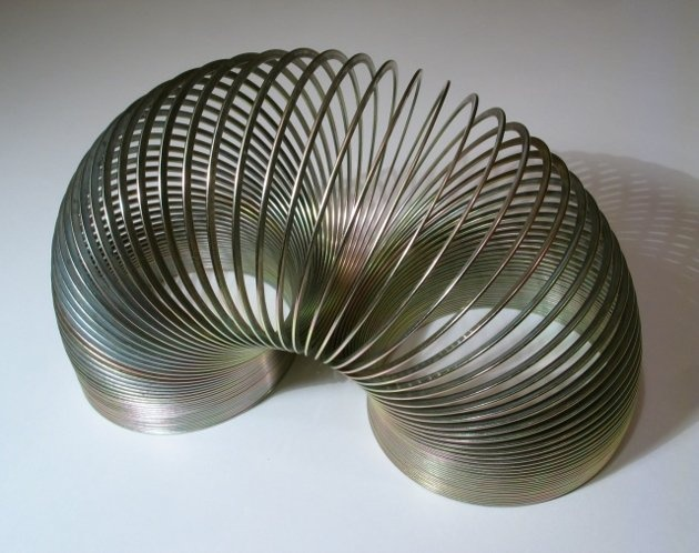 SLINKY  Made in the USA? YES  When naval engineer Richard James accidentally dropped a common torsion apring in 1943, it's curious movement pattern caught his eye. A classic American toy was born. Seventy years later Slinkies are still in production at a factory in Hollidaysburg, PA, & on equipment designed & engineered by James himself. (Trending Now)